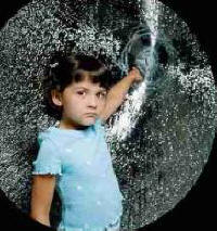 Image of  girl next to shattered window with safety window film applied