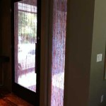 Image of Front door from the interior with custom reed film installed